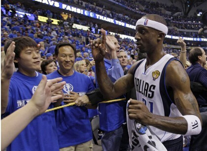 Dallas Mavericks' Jason Terry celebrates with fans after Game 5 of the NBA Finals basketball game against the Miami Heat Thursday, June 9, 2011, in Dallas. The Mavericks won 112-103 to take a 3-2 lead in the series. (AP Photo/Mark Humphrey)