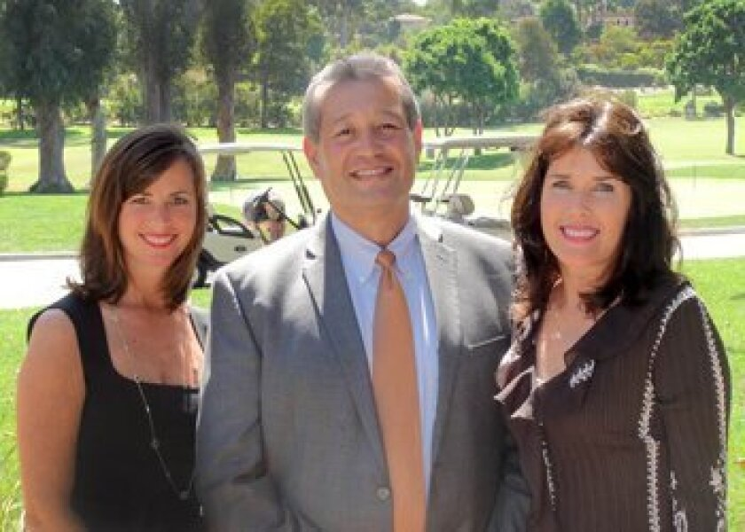 (L-R) Kim Smart, RSF Community Center board member; Al Castro, general manager of the RSF Golf Club; and Linda Durket, executive director of the RSF Community Center.