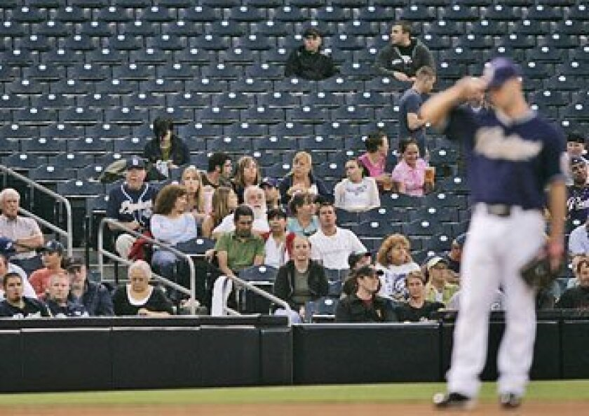 A sparse crowd along the third-base line watched the Padres play the Diamondbacks last week at Petco Park. (Sean M. Haffey / Union-Tribune)
