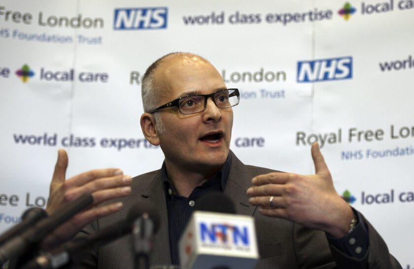 Dr. Michael Jacobs, an infectious diseases consultant, discusses the condition of Ebola patient Pauline Cafferkey at the Royal Free Hospital in London on Dec. 31.