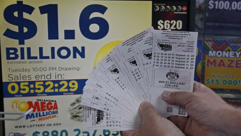 A customer who did not want to be identified displays $200 worth of Mega Millions tickets he bought in Oklahoma City on Tuesday.