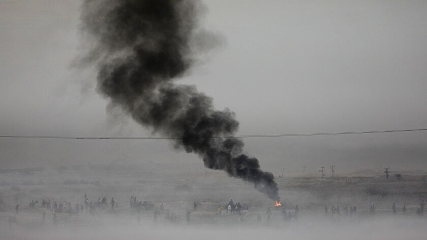 Smoke from Israeli tear gas fills the air during clashes near the border in the east of Gaza City, Gaza Strip on Dec. 27.