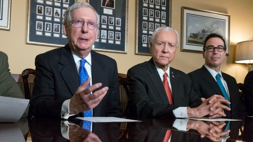 Senate Majority Leader Mitch McConnell, R-Ky., Senate Finance Committee Chairman Orrin Hatch, R-Utah, and Treasury Secretary Steven Mnuchin speak to reporters about the GOP tax reform bill in Washington on Nov. 9.
