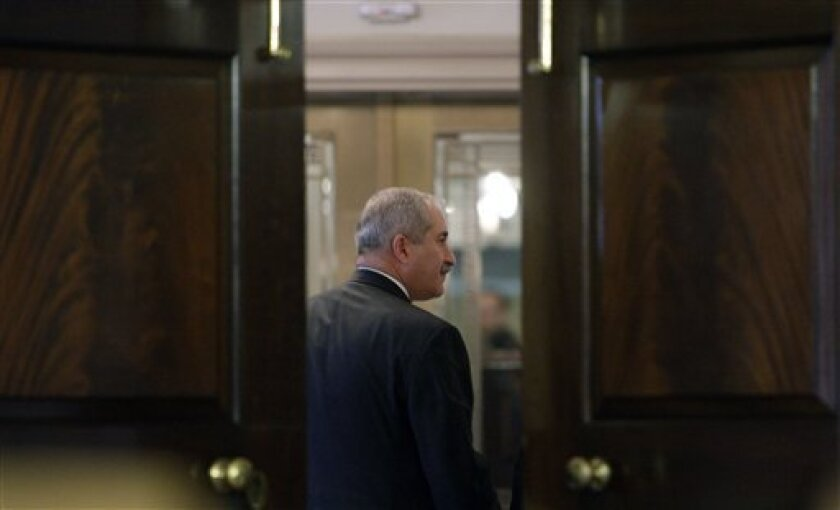 Jordan's Foreign Minister Nasser Judeh, walks out as the doors close after a joint news conference with Secretary of State Hillary Rodham Clinton, not shown, Friday, Jan. 8, 2010, at the State Department in Washington. (AP Photo/Alex Brandon)