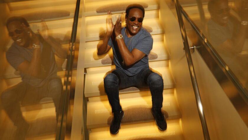 GRANADA HILLS, CA - JUNE 26, 2018 - Veteran R&B singer Charlie Wilson claps to the sound of one of h