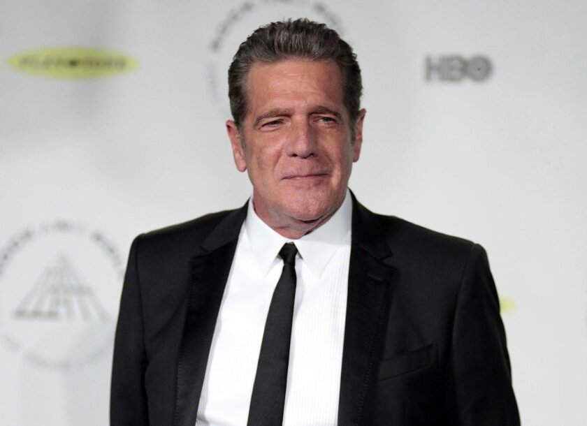 FILE - In this April 10, 2014 file photo, Glenn Frey appears at the 2014 Rock and Roll Hall of Fame Induction Ceremony in New York. Singer and songwriter Jackson Browne will join members of the Eagles to give a tribute to the band's founding member Glenn Frey during 58th annual Grammy Awards on Feb
