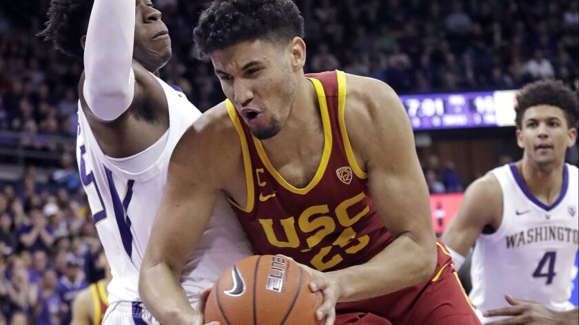 USC's Bennie Boatwright, right, tries to muscle past Washington's Noah Dickerson during the first half on Wednesday in Seattle.