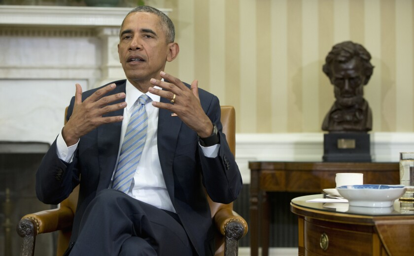 President Obama talks to reporters in the Oval Office on Feb. 17.