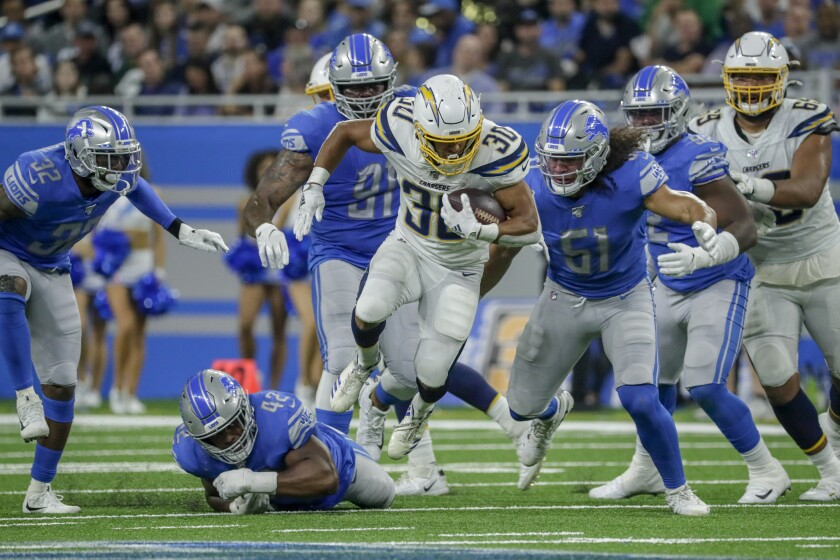 Chargers running back Austin Ekeler breaks past the line for a long run during Sunday's loss to the Lions.