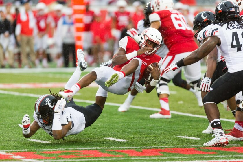 Houston quarterback Greg Ward, Jr. (1)  is hit by Cincinnati's Leviticus Payne (9) during the first half of an NCAA college football game at TDECU Stadium, Saturday, Nov. 7, 2015, in Houston. (AP Photo/Juan DeLeon)