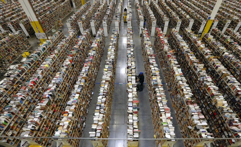 Companies that complain their products are being unfairly counterfeited are up against digital marketplaces that say they work to combat fake merchandise, but have acknowledged that they don't catch every listing. Above, an Amazon fulfillment center.