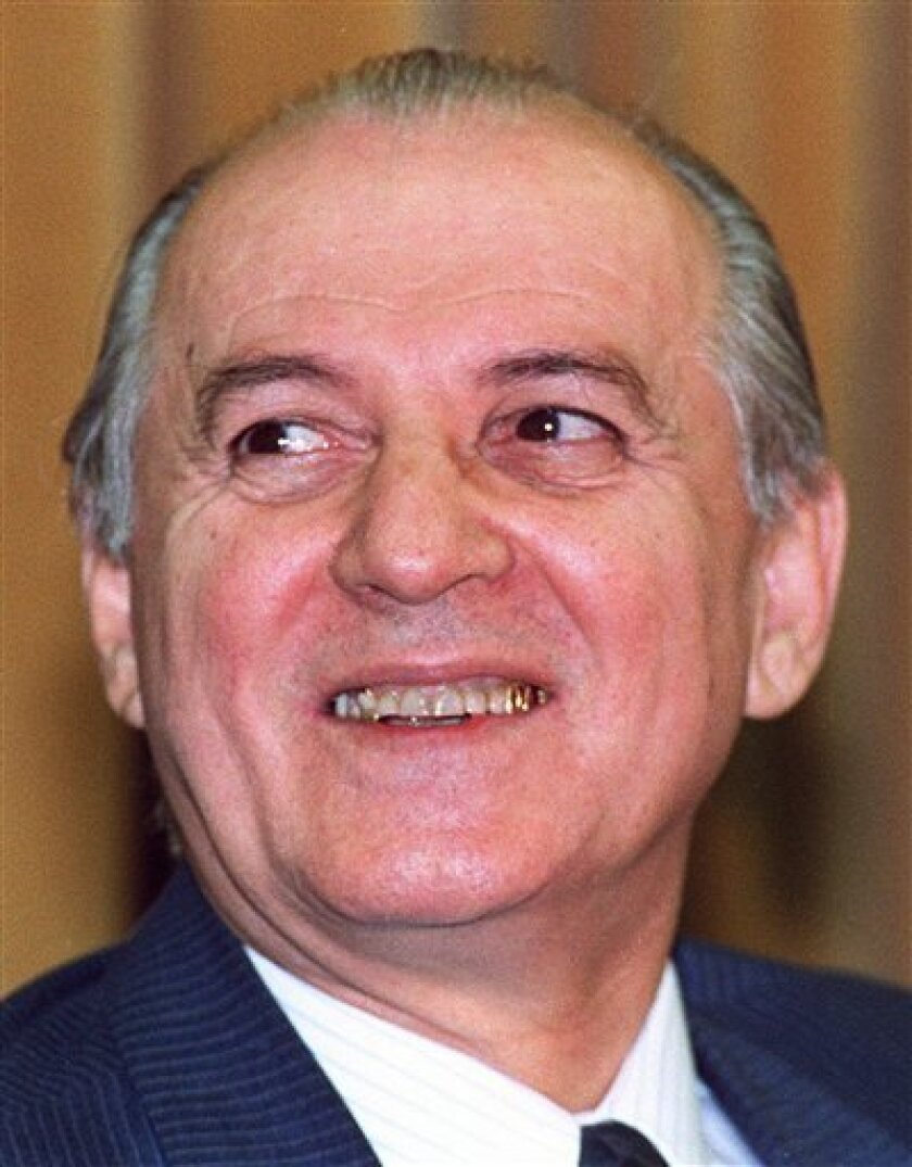 FILE - In this March 30, 1991 file photo, Albanian President Ramiz Alia, attends a press conference in Tirana, Albania. Albania's last communist president Ramiz Alia died in the Balkan country's capital Tirana on Friday, Oct. 7, 2011. He was 85. (AP Photo/Giulio Broglio, File)