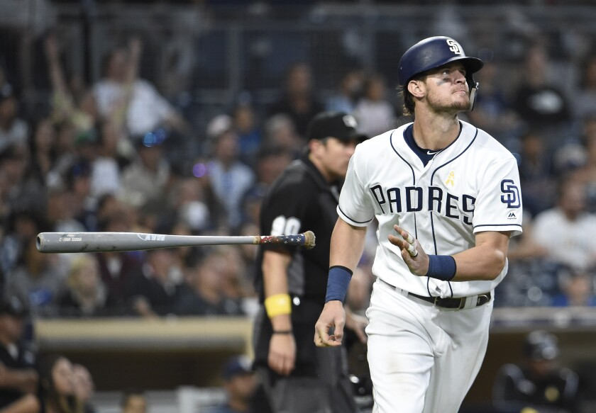 The Padres' Wil Myers flips his bat after hitting a solo home run during the fifth inning of a baseball game against the Colorado Rockies at Petco Park.