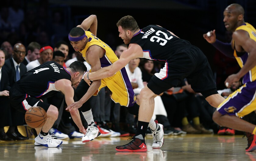 Lakers guard Jordan Clarkson steals the ball from the Clippers' J.J. Redick, left, and Blake Griffin during a game at Staples Center.