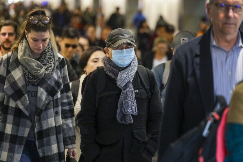 A commuter wears a face mask at Union Station in Los Angeles