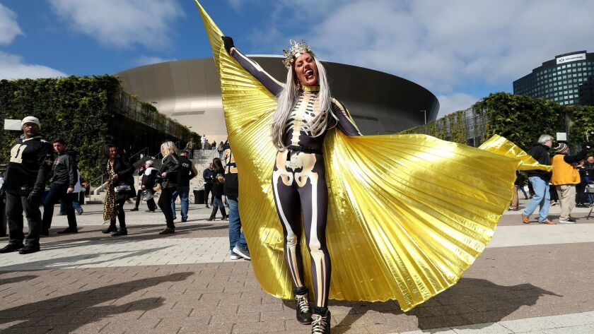 A Saints fan shows her support for the team outside the Superdome on Sunday.