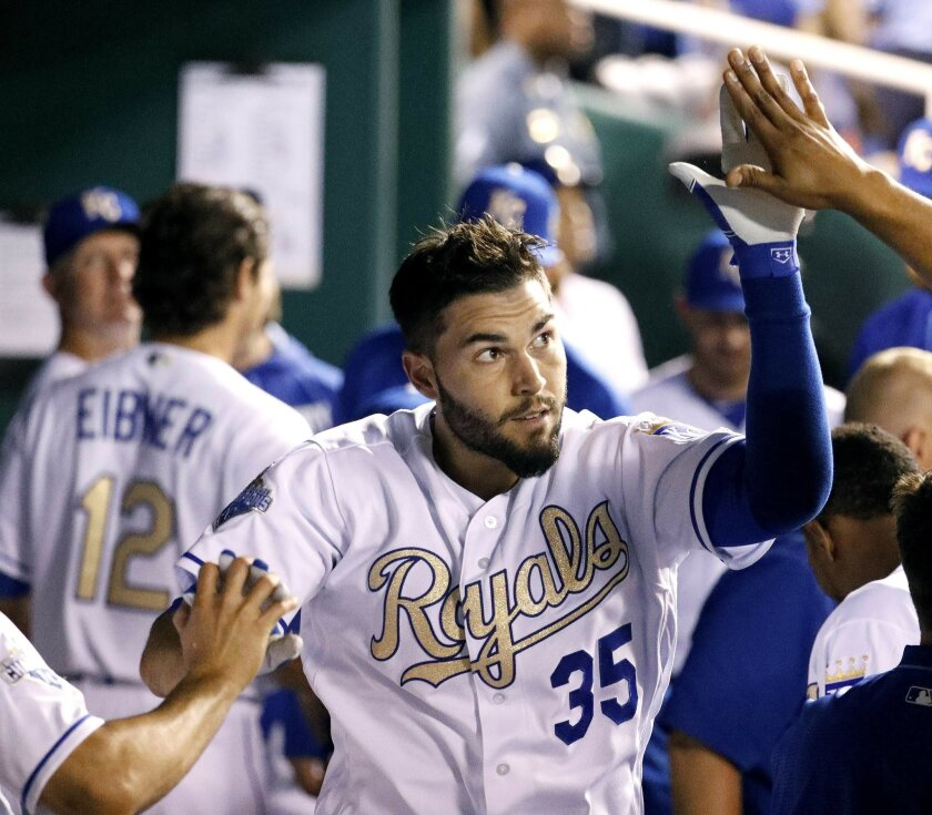 Kansas City Royals' Eric Hosmer celebrates in the dugout after hitting a solo home run during the sixth inning of a baseball game against the Chicago White Sox, Friday, May 27, 2016, in Kansas City, Mo. (AP Photo/Charlie Riedel)