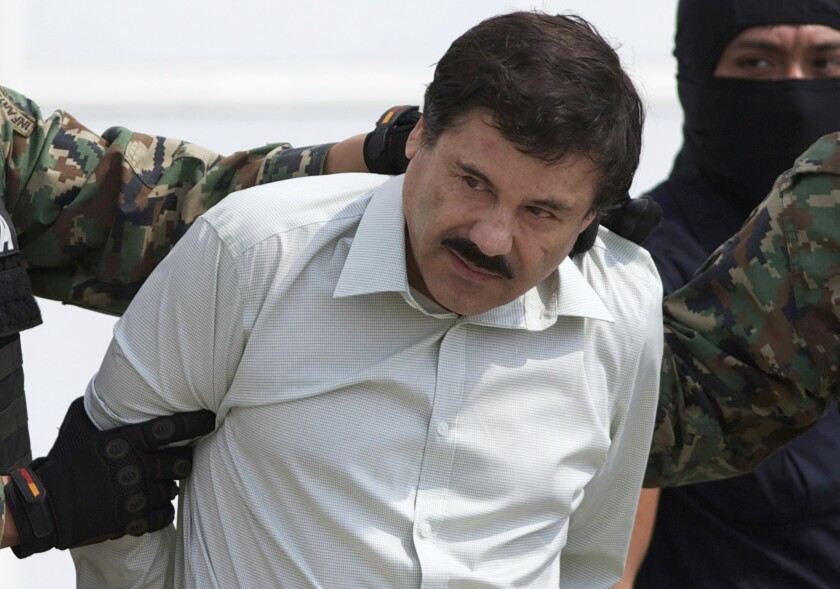 "Joaquin ""El Chapo"" Guzman, head of Mexico's Sinaloa Cartel, is escorted to a helicopter in Mexico City after his February 2014 capture in Mazatlan."
