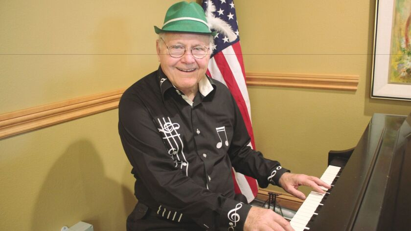 John Meyer plays piano and sings at the White Sands senior living community.