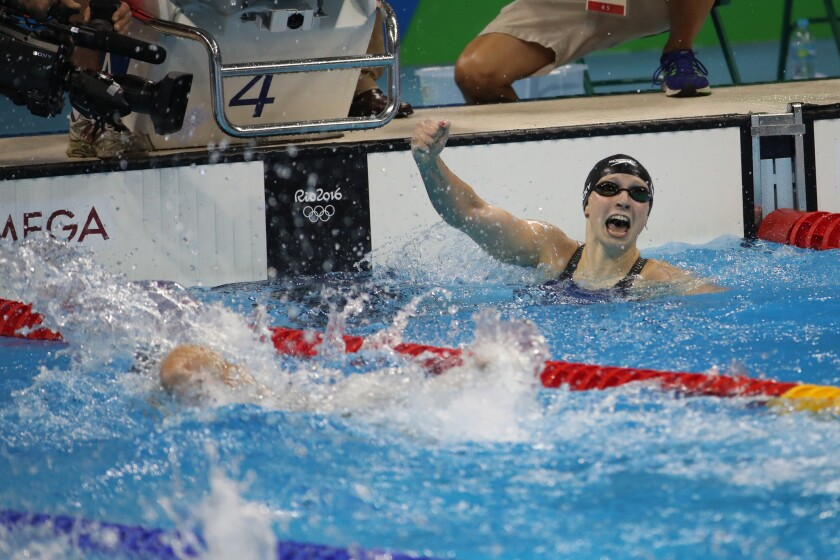 While other competitors are still swimming to the finish, Katie Ledecky of the U.S. is already celebrating after winning the women's 400-meter freestyle in world-reocrd time at the Olympic Aquatics Stadium in Rio de Janeiro.