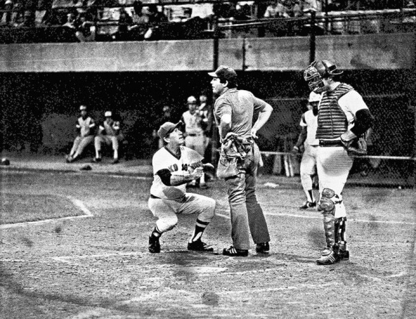Pawtucket manager Joe Morgan argues with home plate umpire Denny Cregg. Cregg would toss Morgan from the game in the top of the 22nd inning.
