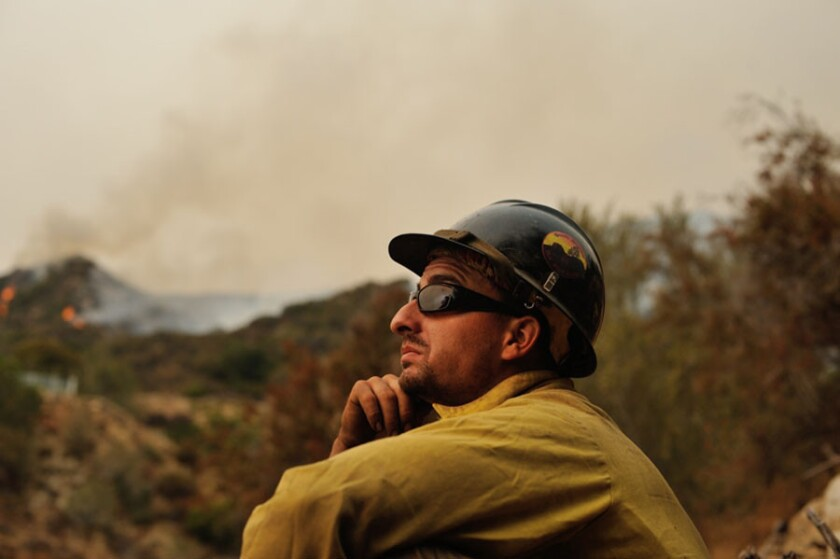 Gregory G. Miller took this photo of Clayton Whitted, a member of the Granite Mountain Hotshots, as Whitted battled the Station fire in the hills above La Crescenta in 2009. Whitted died in last week's Arizona wildfire.