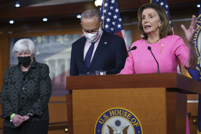 "Speaker of the House Nancy Pelosi, D-Calif., right, Treasury Secretary Janet Yellen, left, and Senate Majority Leader Chuck Schumer, D-N.Y., update reporters on Democratic efforts to pass President Joe Biden's ""Build Back Better"" agenda, at the Capitol in Washington, Thursday, Sept. 23, 2021. (AP Photo/J. Scott Applewhite)"