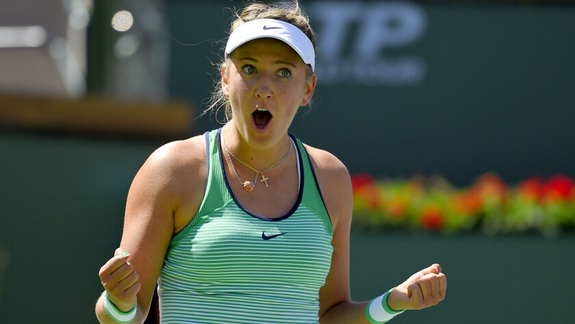 Victoria Azarenka reacts after defeating Serena Williams in a women's final at the BNP Paribas Open on Sunday in Indian Wells.