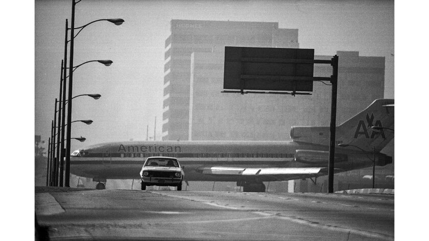 March 14, 1976: Thanks to a long telephoto lens, cross traffic on Sepulveda Blvd. at Los Angeles International Airport appears to be an American Airlines jet.
