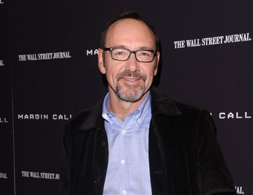 """FILE - This Oct. 17, 2011 file photo shows actor Kevin Spacey attending the premiere of """"Margin Call"""" in New York. Netflix's highly anticipated original series """"House of Cards"""" will premiere Feb. 1. The subscription video company announced the debut date Thursday. The series is the most ambitious effort yet by Netflix to supply its 27 million streaming users with original programming. The remake of the classic British miniseries stars Kevin Spacey and Robin Wright. (AP Photo/Peter Kramer, file)"""