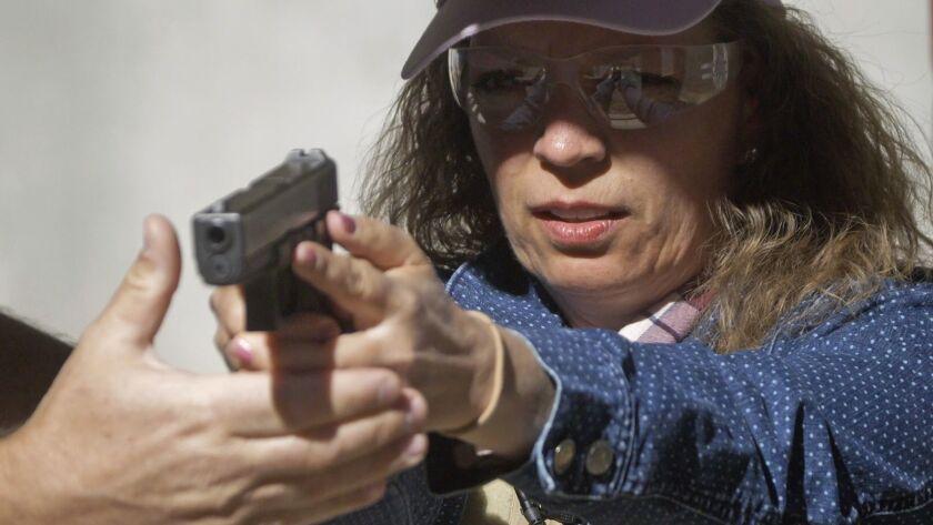 School secretary Cindy Bullock takes part in shooting drills in Utah.