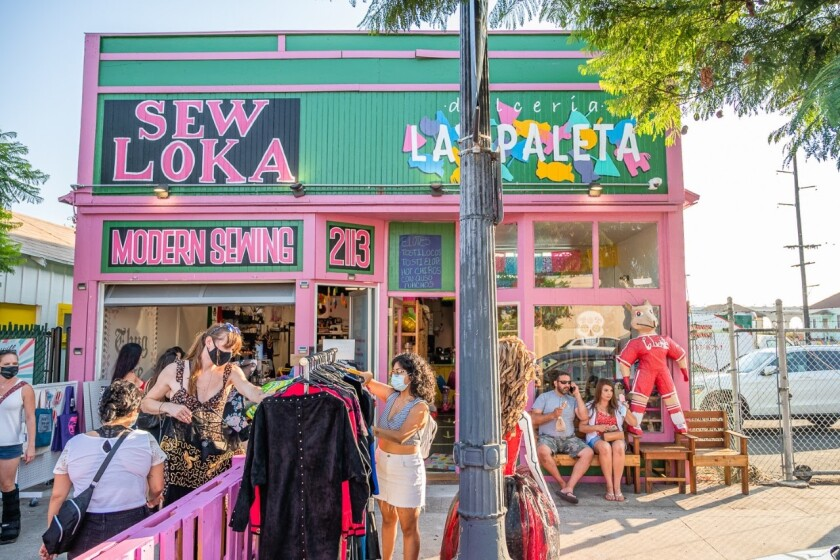 Customers browse merchandise outside Sew Loka during Walk The Block in Barrio Logan on Aug. 22, 2020