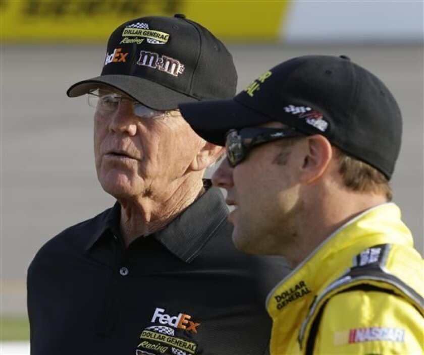 Team owner Joe Gibbs, left, talks with Matt Kenseth during qualifying for Saturday's Sprint Cup race at Richmond International Raceway in Richmond, Va., Friday April 26, 2013. Kenseth won the pole for Saturday's Sprint Cup race. (AP Photo/Steve Helber)