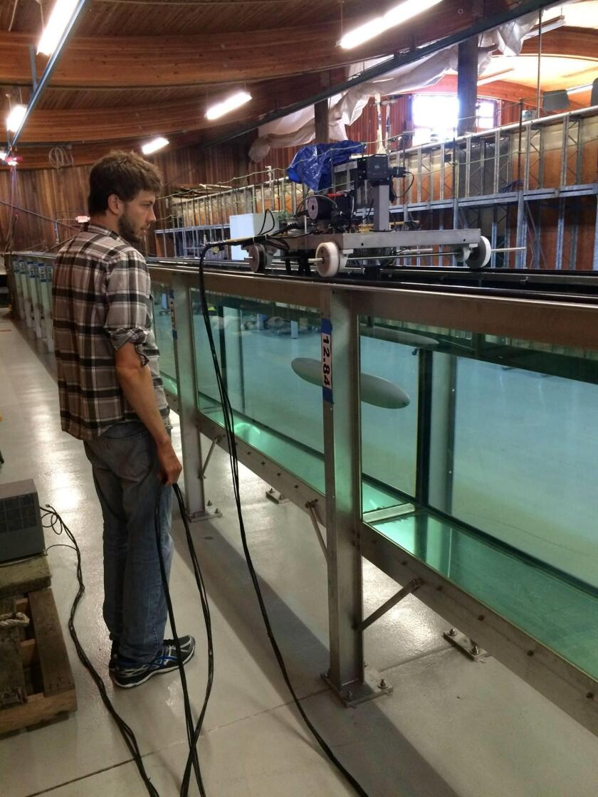 Senior Development Engineer Ben Reineman tests the drag on a new hull design for a Spray Glider in the Glass Walled Wave Channel. (Spray Gliders are autonomous underwater platforms that measure ocean features like temperature, salinity and pressure.)
