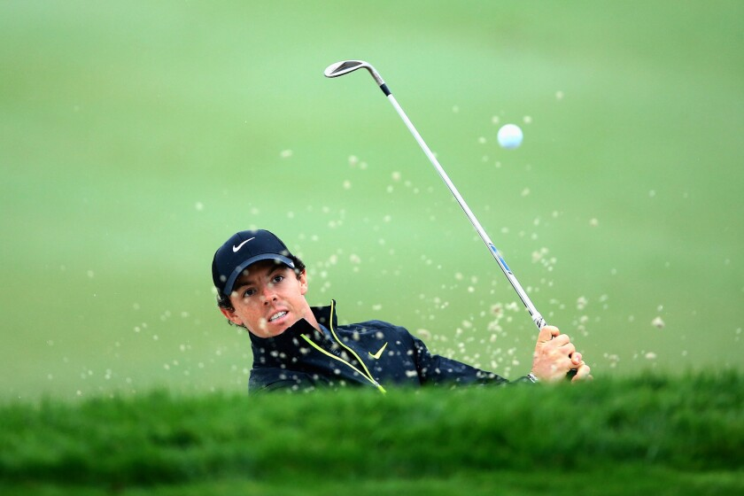 Rory McIlroy hits a shot out of a greenside bunker at No. 4 on Friday during the second round of the Honda Classic.