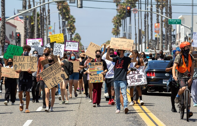 Some of the estimated 100 people in a Black Lives Still Matter demonstration march down Coast Highway to Oceanside Boulevard.