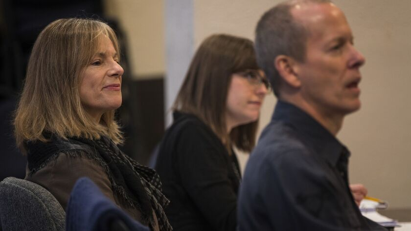 """COSTA MESA, CA - MARCH 15, 2018: Playwright Amy Freed, middle, sits in on a rehearsal for her play """""""
