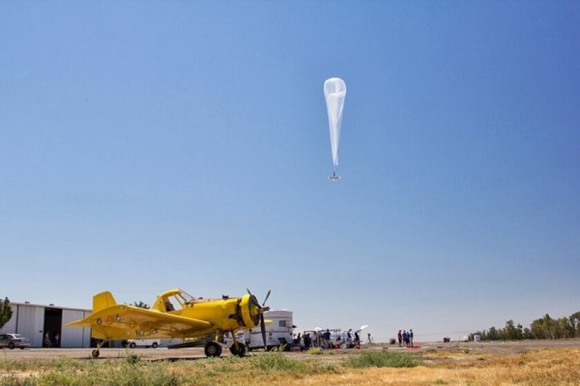 A balloon carrying Wi-Fi equipment floats over California's Central Valley during a research flight for Google's Projects Loon.