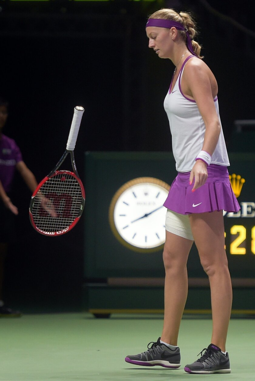 Petra Kvitova of the Czech Republic throws her racket in frustration as she plays against Agnieszka Radwanska of Poland during the singles final at the WTA tennis finals in Singapore on Sunday, Nov. 1, 2015.  (AP Photo/Joseph Nair)