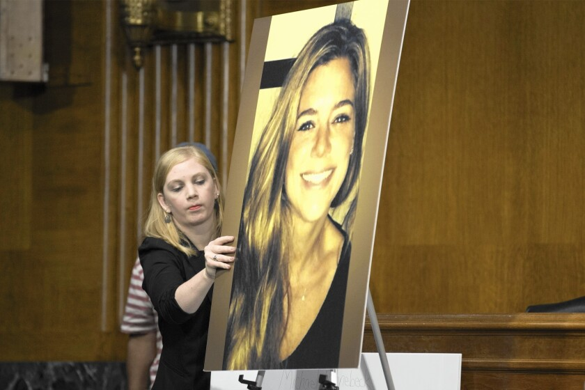A photo of Kathryn Steinle is displayed at a Senate Judiciary Committee hearing in Washington. Steinle was shot and killed on San Francisco's Pier 14 on July 1. The immigrant felon charged in her death had been deported five times to his native Mexico.