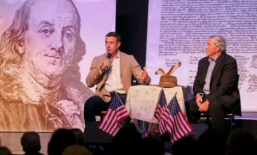 Congressman Duncan Hunter, left, and his father, retired Congressman Duncan L. Hunter, speak about border issues at their town hall meeting at the Ramona Mainstage theater Saturday.
