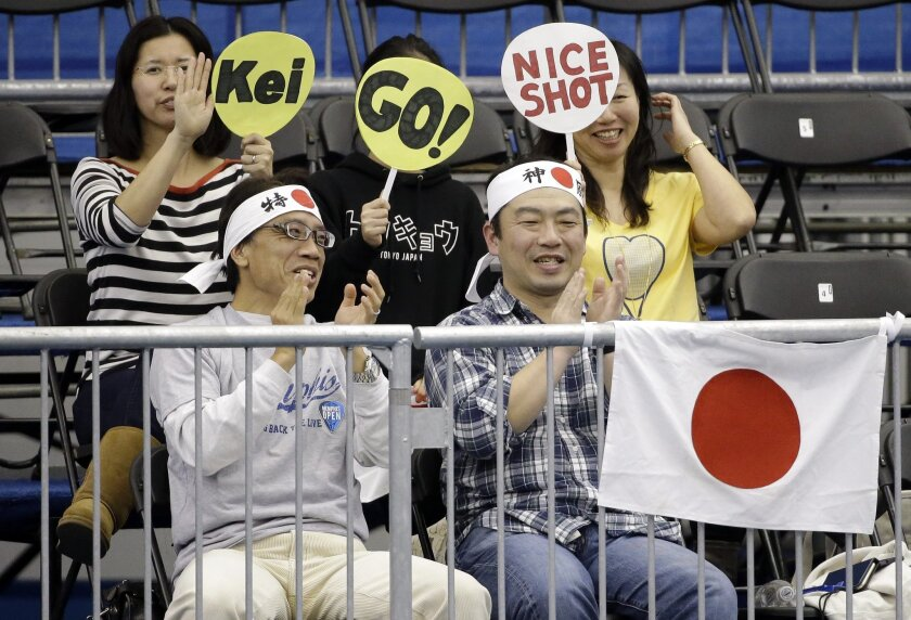 Fans cheer for Kei Nishikori, of Japan, during his quarterfinal win against Mikhail Kukushkin, of Kazakhstan, at the Memphis Open tennis tournament Friday, Feb. 12, 2016, in Memphis, Tenn. (AP Photo/Mark Humphrey)