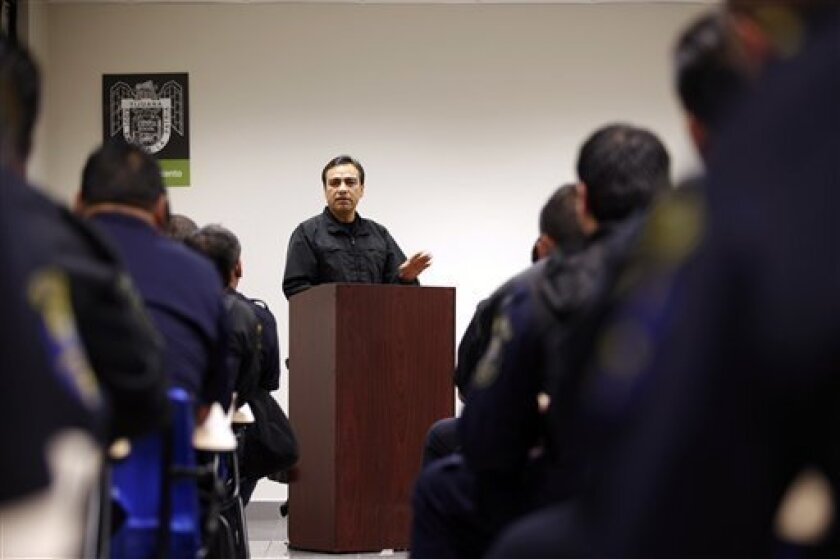 In this Nov. 23, 2009 photo, Tijuana's Public Safety Chief Julian Leyzaola speaks with his police officers in Tijuana, Mexico. Leyzaola is leading the most aggressive police reform to date, a mix of counterterrorism and community policing. If it works, it would be a model for other hotspots and a huge breakthrough in a drug war that has taken more than 14,000 lives in Mexico since it was launched three years ago. (AP Photo/Guillermo Arias)
