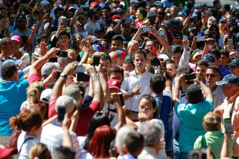 The head of Brazil's opposition-controlled National Assembly, Juan Guaido (c, facing camera), speaks to a large crowd on Jan. 13, 2019, in Caraballeda, Brazil. EFE-EPA/Cristian Hernandez