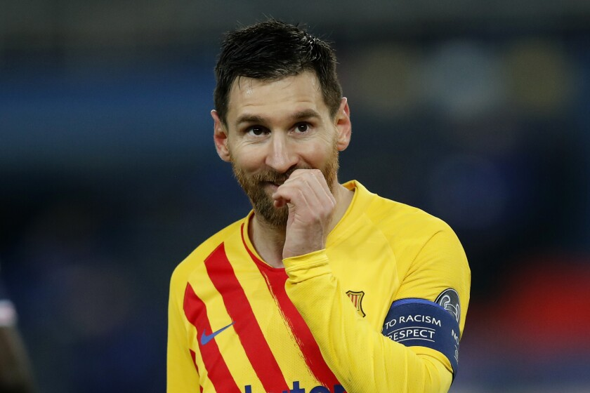 Barcelona's Lionel Messi reacts after a missed a penalty shot during the Champions League, round of 16, second leg soccer match between Paris Saint-Germain and FC Barcelona at the Parc des Princes stadium in Paris, Wednesday, March 10, 2021. (AP Photo/Christophe Ena)