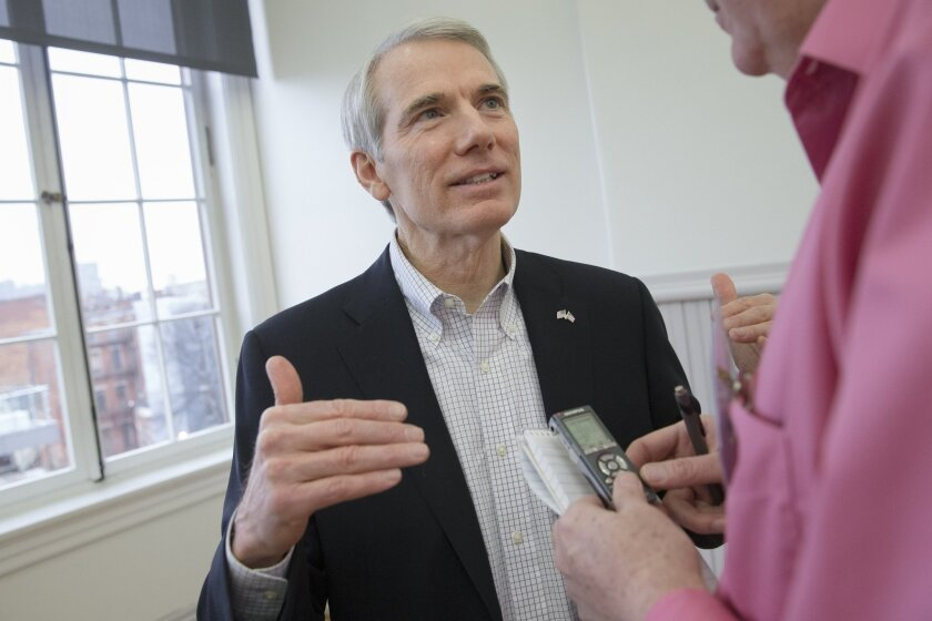 In this Feb. 17, 2016, photo, Sen. Rob Portman, R-Ohio, speaks to a reporter during the Queen City Mobile Summit at Union Hall,in Cincinnati. Portman faces a tough re-election in his swing state of Ohio, and it just got more complicated amid the partisan fight over whether President Barack Obama sh