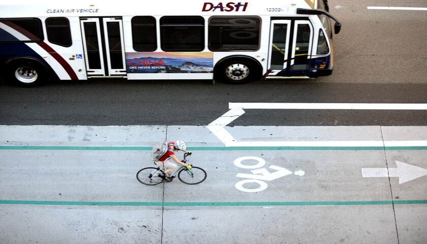 A cyclist uses a bike lane in downtown Los Angeles. The California Environmental Quality Act, known as CEQA, has stymied bike lanes up and down the state for more than a decade.