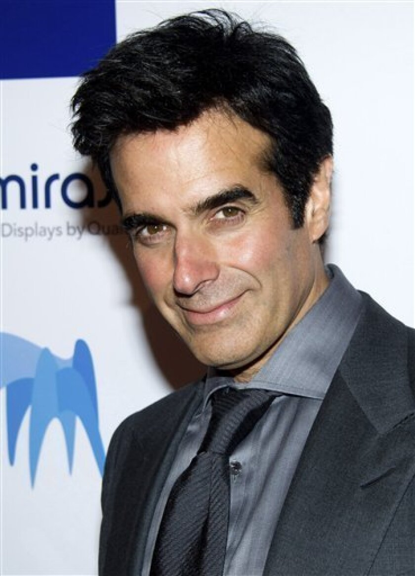 """FILE -In this May 9, 2011 file photo, magician David Copperfield attends the 46th Annual 2011 National Magazine Awards in New York. Early Monday morning, March 4, 2013, the private plane carrying Copperfield made an unscheduled stop at Peoria International Airport in Illinois after it made a """"frigh"""