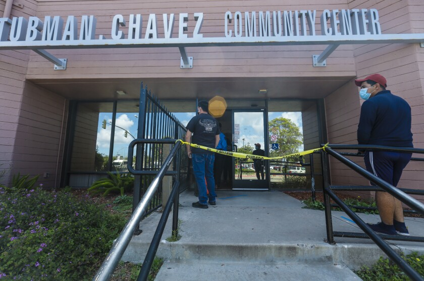 Several people waited in line Tuesday at the Tubman Chavez Community Center, where a state-run COVID-19 test site was opened for appointments.