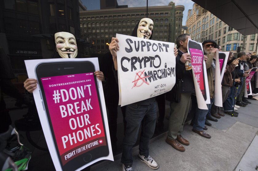 People rally in front of an Apple Store in San Francisco to show support for Apple.